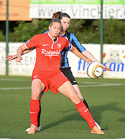 20140606 - Koksijde , BELGIUM : Twente's Anouk Dekker (l) pictured with Brugge's Heleen Jaques (r) during the soccer match between the women teams of Club Brugge Vrouwen  and FC Twente Vrouwen  , on the 30th matchday of the BeNeleague competition on Friday 6th June 2014 in Koksijde .  PHOTO DAVID CATRY