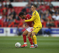 Fleetwood Town's Ashley Hunter  battles with Nottingham Forest's Tiago Silva<br /> <br /> Photographer Mick Walker/CameraSport<br /> <br /> The Carabao Cup First Round - Nottingham Forest v Fleetwood Town - Tuesday 13th August 2019 - The City Ground - Nottingham<br />  <br /> World Copyright © 2019 CameraSport. All rights reserved. 43 Linden Ave. Countesthorpe. Leicester. England. LE8 5PG - Tel: +44 (0) 116 277 4147 - admin@camerasport.com - www.camerasport.com