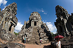 Tourists visit temples in the ancient city of Angkor, in northwestern Cambodia, near Siem Reap.