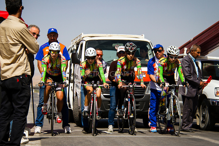 SULAIMANIYAH, IRAQ: Members of Newroz cycling club line up on the start line before competing in team time trials. Nyan Yassin is second from left.<br /> <br /> Nyan Yassin, 24, is a professional competitive cyclist in Sulaimaniyah in the semi-autonomous region of Iraqi Kurdistan.  She is the captain of an all-female club called Newroz Club, which is the only cycling club for women in Sulaimaniyah, although there are other clubs around Iraq.  She trains and competes on roads that are badly surfaced and busy with traffic.<br /> <br /> Nyan was the first woman to start cycling in Sulaimaniyah.  She was always competitive and after trying her hand at different sports she settled on cycling.  She is now the top female cyclist in Iraq.  Her nickname is MigMig after the noise made by the cartoon character Roadrunner.<br /> <br /> Despite being clearly talented at her sport Nyan knows that in a couple of years she will have to get married and then abandon it as, in the traditional society that Kurdistan is, being a wife and a competitive sportswoman at the same time is not an option.<br /> <br /> Photo by Gona Hassan/Metrography