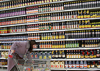 A shopper checks out a variety of soy sauce on offer at a Carrefour Supermarket in Shanghai, China. According to a recent report, China has surpassed the United States in total consumption of every basic food, energy, and industrial commodity except oil, as well as goods such as television sets, refrigerators and mobile phones. However the per capita income for China is only roughly one seventh of that of the U.S..19 Feb 2005