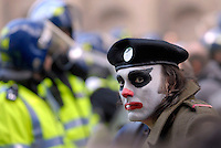 A demonstrator with clown make-up and military dress outside the Bank of England. Thousands of protestors descended on the City of London ahead of the G20 summit of world leaders to express anger at the economic crisis, which many blame on the excesses of capitalism.....