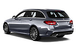 Car pictures of rear three quarter view of a 2018 Mercedes Benz C Class AMG Line 5 Door Wagon angular rear