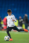Cristiano Ronaldo Jr, son of Cristiano Ronaldo of Real Madrid, plays with a ball after the UEFA Champions League 2017-18 Round of 16 (1st leg) match between Real Madrid vs Paris Saint Germain at Estadio Santiago Bernabeu on February 14 2018 in Madrid, Spain. Photo by Diego Souto / Power Sport Images