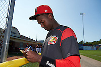 Batavia Muckdogs third baseman Javier Lopez (23) signs autographs before the second game of a doubleheader against the Auburn Doubledays on September 4, 2016 at Dwyer Stadium in Batavia, New York.  Batavia defeated Auburn 6-5. (Mike Janes/Four Seam Images)