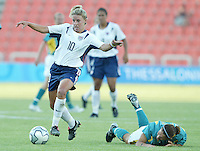 17 August 2004:   Aly Wagner dribbles the ball away from Australia defender  at Kaftanzoglio Stadium in Thessaloniki, Greece.     USA tied Australia at 1-1.   Credit: Michael Pimentel / ISI
