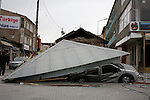 ERCIS, TURKEY: A car, crushed by a falling roof...On October 23, 2011, a 7.2 magnitude earthquake hit eastern Turkey killing over 250 people and wounding over a thousand...Photo by Marwa Al Zahawe/Metrography