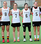 FRANKFURT AM MAIN, GERMANY - April 14: Inga Hupka #8 of Germany, Pia Balz #7 of Germany, Mareile Kriwall #6 of Germany and Henrike Voigt #5 of Germany during the national anthem before the Deutschland Lacrosse International Tournament match between Germany vs Great Britain during the on April 14, 2013 in Frankfurt am Main, Germany. Great Britain won, 10-9. (Photo by Dirk Markgraf)