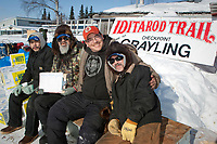 The checking crew at Grayling pose for a photo during Iditarod 2009