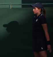 A ball girl and her shadow<br /> <br /> Photographer Rob Newell/CameraSport<br /> <br /> Wimbledon Lawn Tennis Championships - Day 1 - Monday 1st July 2019 -  All England Lawn Tennis and Croquet Club - Wimbledon - London - England<br /> <br /> World Copyright © 2019 CameraSport. All rights reserved. 43 Linden Ave. Countesthorpe. Leicester. England. LE8 5PG - Tel: +44 (0) 116 277 4147 - admin@camerasport.com - www.camerasport.com