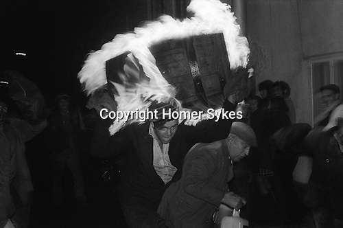 Tar Barrel Rolling, Ottery St Mary, Devon, England 1973. November 5th. Flaming tar barrels are run through the street of the village during the night.