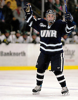 "5 January 2007: University of New Hampshire defenseman Brad Flaishans (19) from Glendale, AZ, celebrates a goal against the University of Vermont Catamounts at Gutterson Fieldhouse in Burlington, Vermont. The UNH Wildcats defeated Vermont 7-1 in front of a record setting 48th consecutive sellout at ""the Gut""...Mandatory Photo Credit: Ed Wolfstein<br />"
