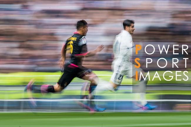 Alvaro Morata of Real Madrid runs with Oscar Duarte of RCD Espanyol during the match Real Madrid vs RCD Espanyol, a La Liga match at the Santiago Bernabeu Stadium on 18 February 2017 in Madrid, Spain. Photo by Diego Gonzalez Souto / Power Sport Images