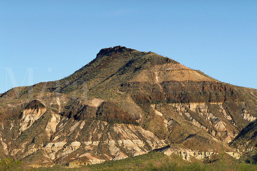 Geology, gravity fault seen on mountain side by displacement of ancient lava flow. Texas, Big Bend Ranch State Park.
