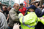 """© Joel Goodman - 07973 332324 . 11/06/2017 . Manchester , UK .  Demonstration against Islamic hate , organised by former EDL leader Tommy Robinson's """" UK Against Hate """" and opposed by a counter demonstration of anti-fascist groups . UK Against Hate say their silent march from Piccadilly Train Station to a rally in Piccadilly Gardens in central Manchester is in response to a terrorist attack at an Ariana Grande concert in Manchester , and is on the anniversary of the gun massacre at the Pulse nightclub in Orlando . Photo credit : Joel Goodman"""