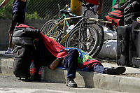 MEDELLÍN, COLOMBIA, MAY 14: A Venezuelan immigrant sleeps outside the bus terminal in Medellín, Colombia, on May 14, 2020. Venezuelan migrants hope to have the opportunity to take a bus to the border due to the new pandemic. . from COVID19. (Photo by Fredy Builes / VIEWpress via Getty Images)