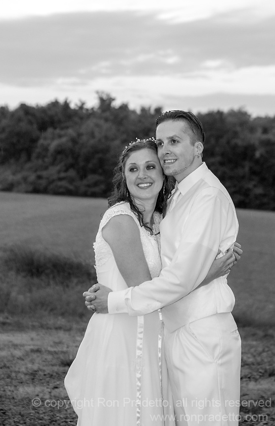 A lake at the White Barn in Prospect, Pa provided the backdrop for Chris and Jen's beautiful wedding. A rain shower after the ceremony created the conditions for a spectacular sunset that lasted only a few minutes. We were fortunate to capture some images of the bride and groom during sunset