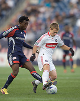 Chicago Fire forward Chris Rolfe (17) dribbles as New England Revolution forward/midfielder Kenny Mansally (29) defends. The New England Revolution out scored the Chicago Fire, 2-1, in Game 1 of the Eastern Conference Semifinal Series at Gillette Stadium on November 1, 2009.