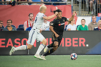 FOXBOROUGH, MA - AUGUST 3: Antonio Mlinar Delamea #19 of New England Revolution and Carlos Vela #10 of Los Angeles FC chase down the ball during a game between Los Angeles FC and New England Revolution at Gillette Stadium on August 3, 2019 in Foxborough, Massachusetts.