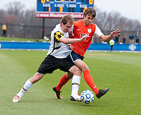 Jereme Raley (12) of Maryland fights for the ball with Riggs Lennon (12) of Virginia during the ACC Finals at the Maryland SoccerPlex in Boyds, MD.  Maryland defeated Virginia, 1-0, to win the title.