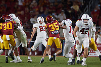 LOS ANGELES, CA - SEPTEMBER 11: Ryan Sanborn #23 of the Stanford Cardinal punts the ball during a game between University of Southern California and Stanford Football at Los Angeles Memorial Coliseum on September 11, 2021 in Los Angeles, California.