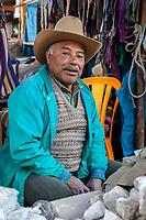 Chichicastenango, Guatemala.  Quiche (Kiche, K'iche') Man Selling Chalk in the Market, used in making whitewash, and in making tortillas.