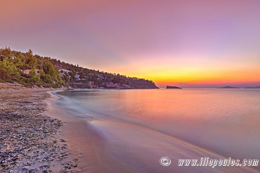 The sunrise at the beach Chrisi Milia of Alonissos island, Greece