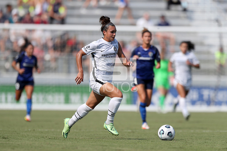 CARY, NC - SEPTEMBER 12: Sophia Smith #9 of the Portland Thorns FC runs with the ball during a game between Portland Thorns FC and North Carolina Courage at Sahlen's Stadium at WakeMed Soccer Park on September 12, 2021 in Cary, North Carolina.