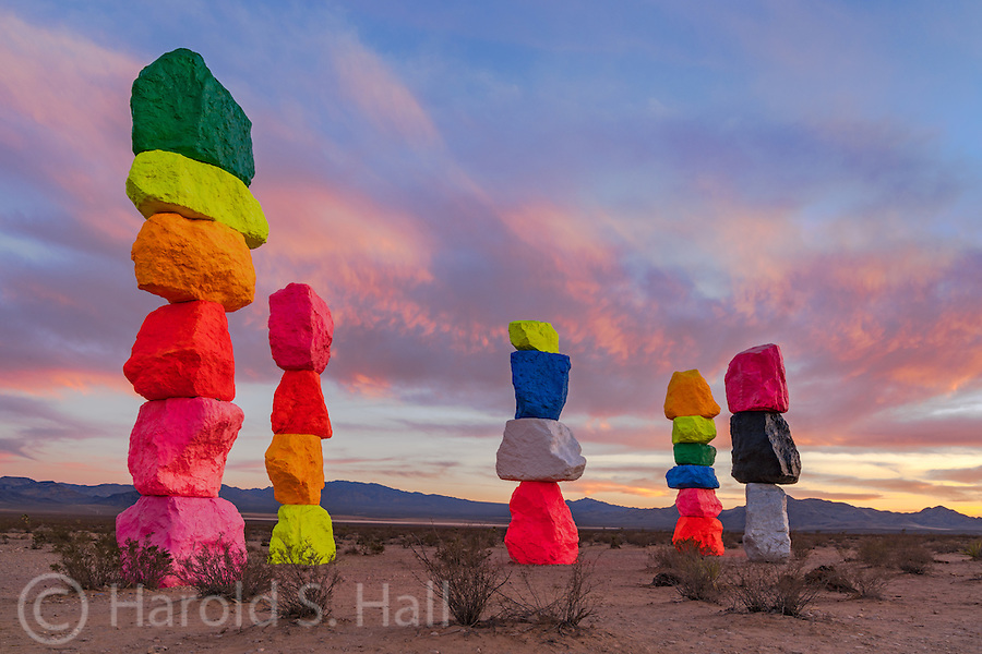 Ten miles or so south of Las Vegas is a new art installation, Seven Magic Mountains.  Seven  florescent painted boulders are stacked 30 feet high.  They could resemble giant marshmallows or simply be a man made structure painted with glow in the dark type colors contrasting with the desert landscape.