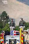 The procession with the casket of Carson City Sheriff's Deputy Carl Howell pauses in front of the Sheriff's office in Carson City, Nev., on Thursday, Aug. 20, 2015, enroute to a memorial service in Reno. Howell was shot and killed early Saturday morning after responding to a domestic violence call. (Cathleen Allison/Las Vegas Review-Journal)