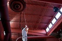 A worker paints light fixtures in the refurbished Bel Lago restaurant on Hoover Reservoir. The restaurant opened two years ago as the Hoover Grill and is being rebuilt as an Italian eaterie. Photo Copyright Gary Gardiner. Not be used without written permission detailing exact usage.