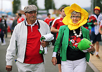 A man and a woman wearing a daffodil hat outside the stadium prior to the Wales  the FIFA World Cup Qualifier Group D match between Wales and Austria at The Cardiff City Stadium, Cardiff, Wales, UK. Saturday 02 September 2017