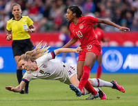 CARSON, CA - FEBRUARY 9: Sam Mewis #3 of the United States is fouled by Ashley Lawerance #10 of Canada during a game between Canada and USWNT at Dignity Health Sports Park on February 9, 2020 in Carson, California.