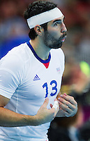08 AUG 2012 - LONDON, GBR - Nikola Karabatic (FRA) of France offers advice to team mates during the men's London 2012 Olympic Games quarter final match against Spain at the Basketball Arena in the Olympic Park, in Stratford, London, Great Britain .(PHOTO (C) 2012 NIGEL FARROW)
