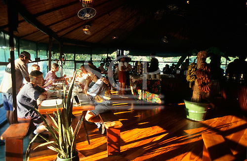Ariau Hotel, Brazil. Tourists enjoying lunch in the comfortable dining room of the ecotourist lodge.