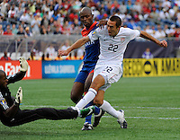 Davy Arnaud (22) of the United States (USA) shoots and scores as Frantz Bertin (6) of Haiti (HAI) defends during the first half of a CONCACAF Gold Cup Group B group stage match between the United States and Haiti at Gillette Stadium in Foxborough, MA, on July 11, 2009. .