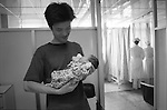 The Peoples Republic of China. Shanghai. 2000.  A father holds his newborn baby boy in the Shanghai Medical Obstetrics and Gynaecological Hospital. Deng Xiaoping introduced the one child policy in 1979 - a complete reversal of Mao Zedung?s policy that had promoted large families. Although accurate statistics are hard to come by, the current estimate of 117 male to 100 female births mean that in twenty years time this little boy will find getting a girlfriend is hard work..