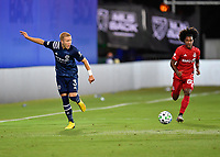 LAKE BUENA VISTA, FL - JULY 26: Anton Tinnerholm of New York City FC passes the ball as Jayden Nelson of Toronto FC looks on during a game between New York City FC and Toronto FC at ESPN Wide World of Sports on July 26, 2020 in Lake Buena Vista, Florida.