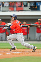 Tanner Mathis (12) of the Greeneville Astros follows through on his swing against the Burlington Royals at Burlington Athletic Park on July 1, 2013 in Burlington, North Carolina.  The Astros defeated the Royals 8-1 in Game Two of a doubleheader.  (Brian Westerholt/Four Seam Images)