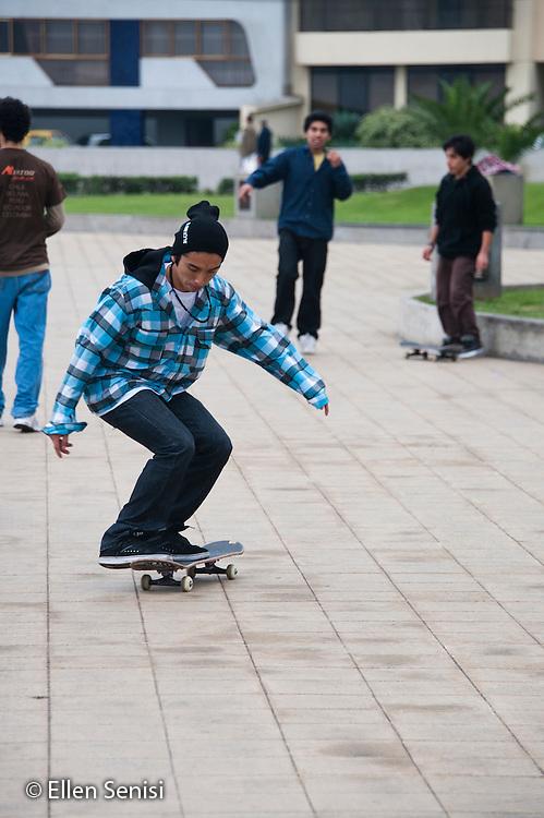 Lima, Peru. Teen (boy, Peruvian) on skateboard. No MR. ID: AL-peru.