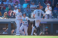 Salt River Rafters Seth Beer (8), of the Arizona Diamondbacks organization, is congratulated by Royce Lewis (9) and Colton Welker (34) after scoring a run during the Arizona Fall League Championship Game against the Surprise Saguaros on October 26, 2019 at Salt River Fields at Talking Stick in Scottsdale, Arizona. The Rafters defeated the Saguaros 5-1. (Zachary Lucy/Four Seam Images)