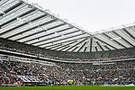 The players line up in front of the huge Milburn and Leazes stands. Newcastle v West Ham, August 15th 2021. The first game of the season, and the first time fans were allowed into St James Park since the Coronavirus pandemic. 50,673 people watched West Ham come from behind twice to secure a 2-4 win.