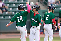 Nick Sogard (11) of the Greenville Drive gets an elbow bump from Tyler Dearden (24) after hitting a home run in a game against the Bowling Green Hot Rods on Sunday, May 9, 2021, at Fluor Field at the West End in Greenville, South Carolina. (Tom Priddy/Four Seam Images)
