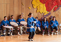 Native Alaskan youth demonstrates the traditional dance of her culture at the Native Alaskan Heritage Center, Anchorage, Alaska, USA.