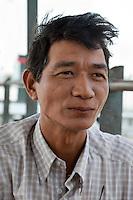 Myanmar, Burma, Yangon.  Burmese Man.