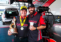 Jul 12, 2020; Clermont, Indiana, USA; NHRA top fuel driver Billy Torrence celebrates with crew member Dom Lagana after winning the E3 Spark Plugs Nationals at Lucas Oil Raceway. This is the first race back for NHRA since the start of the COVID-19 global pandemic. Mandatory Credit: Mark J. Rebilas-USA TODAY Sports