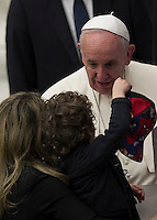 Papa Francesco saluta un bambino al termine dell'udienza generale del mercoledi' in aula Paolo VI, Citta' del Vaticano, 13 gennaio 2016.<br /> Pope Francis greets a child at the end of his weekly general audience in the Paul VI hall at the Vatican, 13 January 2016.<br /> UPDATE IMAGES PRESS/Riccardo De Luca<br /> <br /> STRICTLY ONLY FOR EDITORIAL USE
