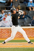 Brett Armour (6) of the Wake Forest Demon Deacons follows through on his swing against the North Carolina Tar Heels at Wake Forest Baseball Park on March 9, 2013 in Winston-Salem, North Carolina.  The Tar Heels defeated the Demon Deacons 20-6.  (Brian Westerholt/Four Seam Images)