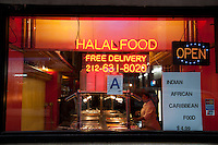 Halal food restaurant window on Manhattan. Sanitary inspection A grade.
