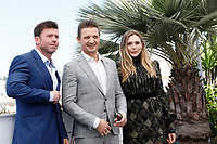 Taylor Sheridan, Jeremy Renner, Elizabeth Olsen at the 'Wind River' photocall during the 70th Cannes Film Festival at the Palais des Festivals on May 20, 2017